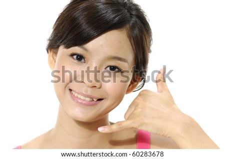 Portrait of young girl making a call me gesture