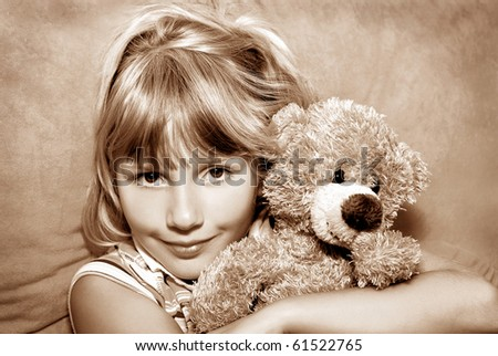 portrait of young girl with her teddy bear in vintage style (sepia)