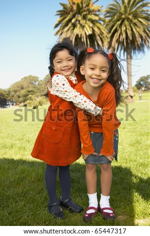Portrait of young girls hugging