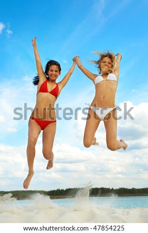 stock photo : Portrait of young girls in bikini jumping during summer ...