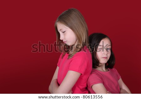 Portrait of young girls on red background