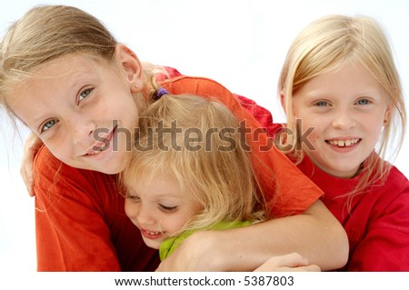 Portrait of young girls wearing red t-shirts