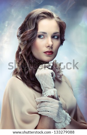 Portrait of young glamorous woman on sparkling background in old Hollywood style