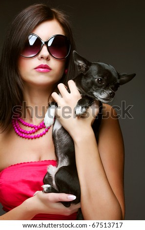 portrait of young glamorous woman with toy-terrier