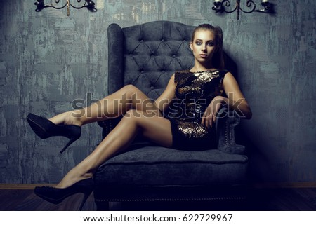 bf908eb86e7e Portrait of young gorgeous long legged model with ponytail and artistic  make-up wearing short