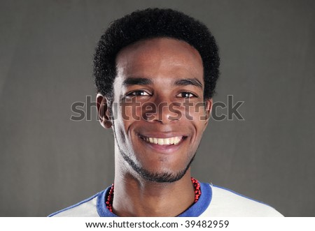 Portrait of young handsome african american man with happy expression