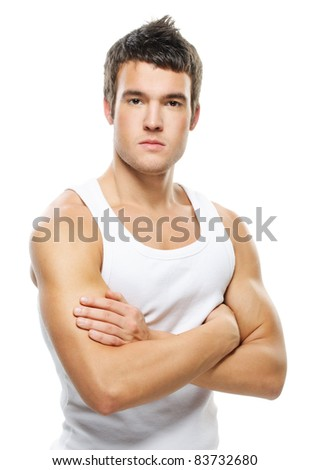Portrait of young handsome brunette man wearing t-shirt against white background.