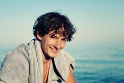 portrait of young handsome man on the beach