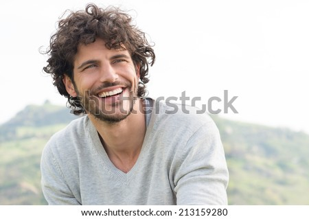 Portrait Of Young Handsome Man Smiling Outdoor #213159280