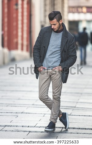 Portrait Of Young Handsome Stylish Man In Elegant Coat Outdoor Fashion Added Filter