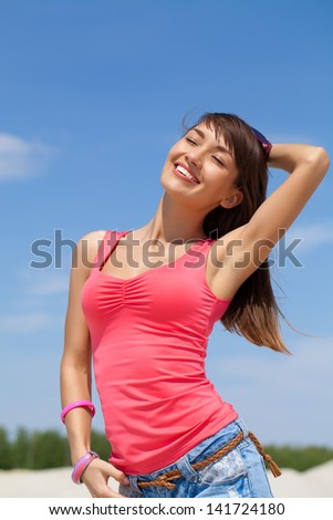 Portrait of young happiness woman in summer time