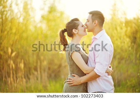 portrait of young happy beautiful couple on nature