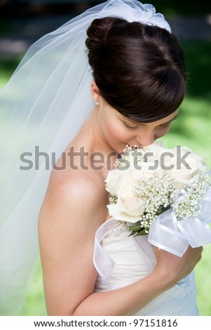 Portrait Of Young Happy Bride With Flower Bouquet.