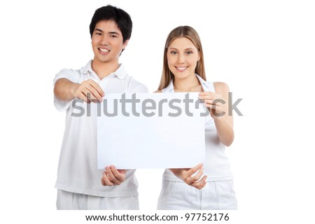 Portrait of young happy couple holding blank placard.