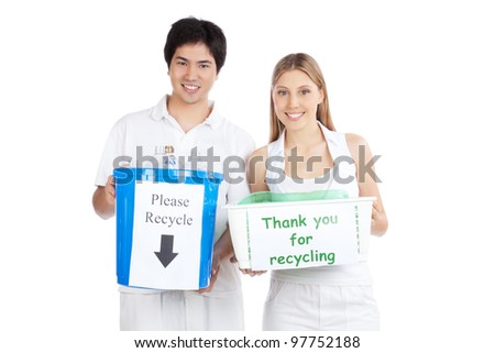 Portrait of young happy couple holding recycle bin .