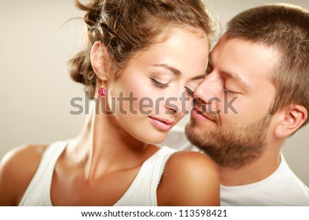 Portrait of young happy  couple, isolated on white background