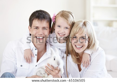 Portrait of young happy family at home
