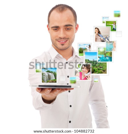 Portrait of young happy man sharing his photo and video files in social media resources using his modern tablet computer. Isolated on white background