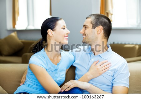 Portrait of young happy smiling attractive cheerful couple at home