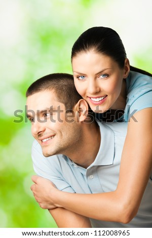 Portrait of young happy smiling attractive couple, outdoors