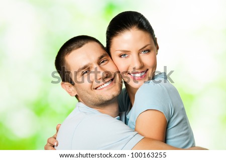 Portrait of young happy smiling cheerful attractive amorous couple, outdoors