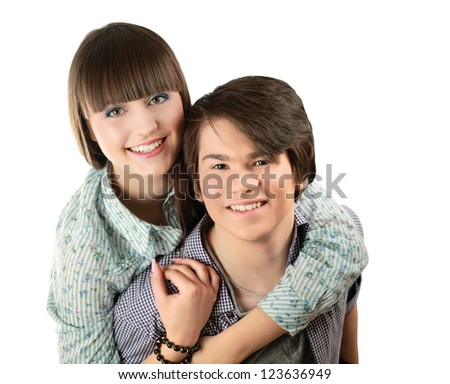 Portrait of young happy smiling couple, isolated on white backgroun