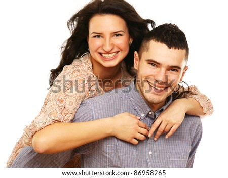 Portrait of young happy smiling couple, isolated on white background