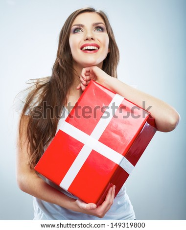 Portrait of young happy smiling woman red gift box hold. Isolated studio background female model.