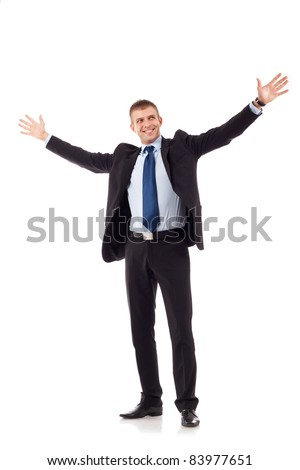 portrait of young, happy winner businessman with arms wide open over white