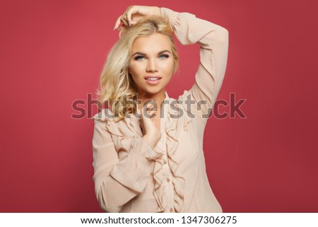 Portrait of young happy woman posing on colorful bright pink background. Blonde girl with blond curly bob hairstyle #1347306275