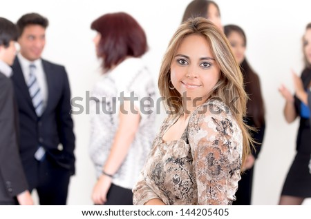 Portrait of young happy woman with her business partners on the background