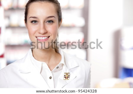 portrait of Young health care worker and background pharmacy.