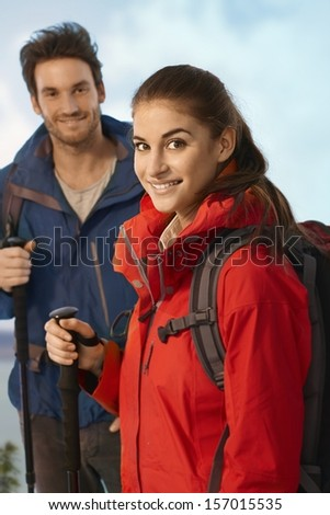 Portrait of young hiker woman smiling at camera.