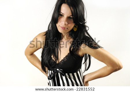 Portrait of young hispanic woman standing with attitude - isolated
