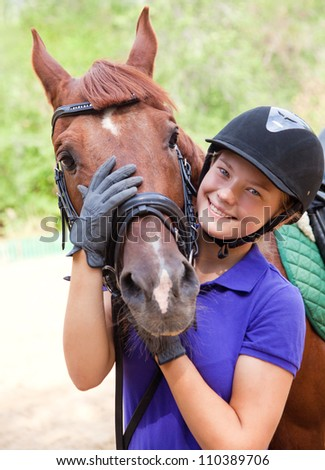 Portrait of young  horsewoman and brown horse