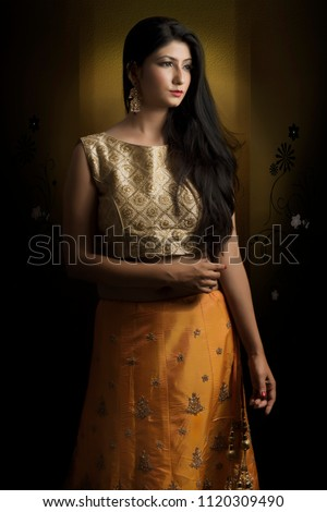 Portrait of young Indian lady in ethnic wear.