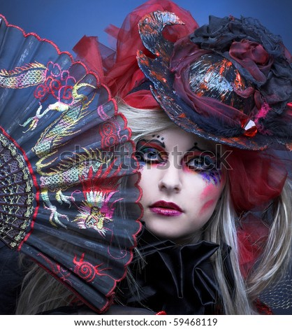 Portrait of young lady in creative image and in exotic hat