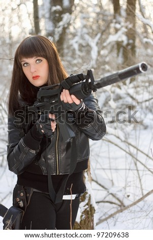 Portrait of young lady with a rifle