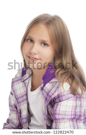 portrait of young little caucasian girl standing over white background