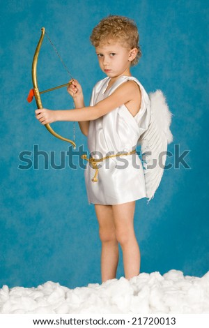 Portrait of young male angel holding bow