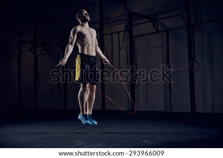 Portrait of young male athlete skipping rope