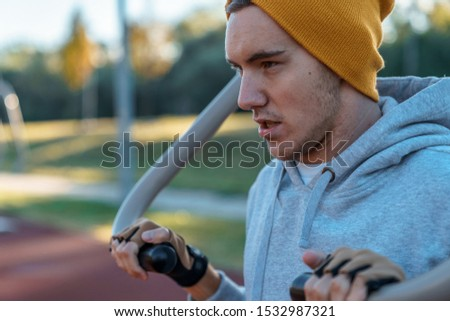Portrait of young male doing morning workout rutine on bridge outdoors. Healthy Lifestyle. Cardiovascular workouts - Stock Image