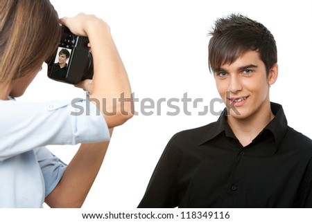 Portrait of young male model posing at camera.Isolated on white.