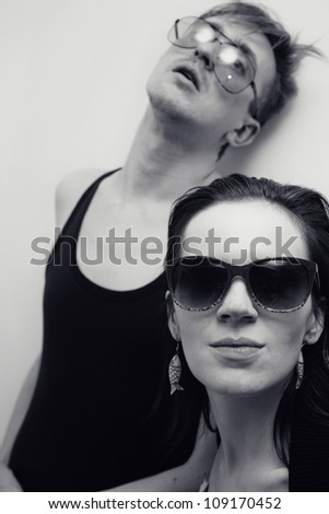Portrait of Young man and woman in sunglasses