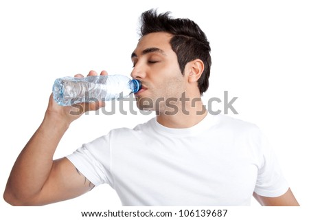 Portrait of young man drinking water from bottle isolated on white background.
