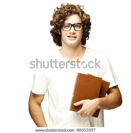 portrait of young man holding books over white background