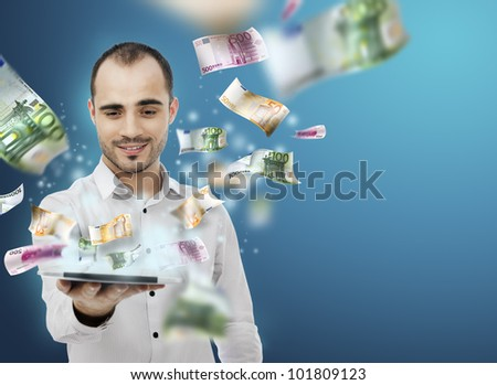Portrait of young man holding the tablet pc and Money Coming out of Touch screen. Concept of business growth and e-trade