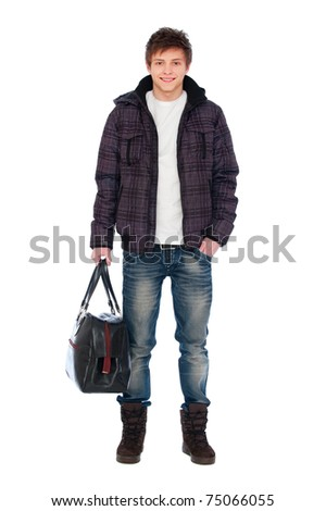 portrait of young man in coat holding bag