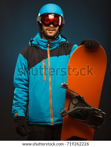 Portrait of young man in sportswear with snowboard. Studio shot. #719262226