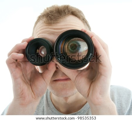 portrait of young man looking through a lens over white background